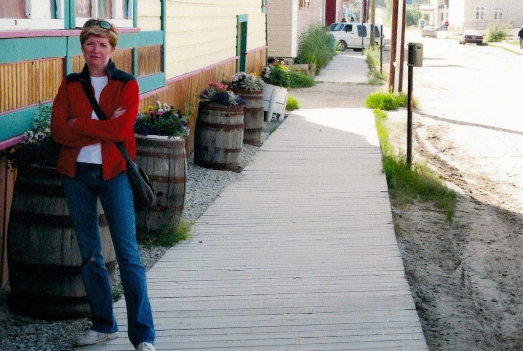 woman on wooden sidewalk in Yukon