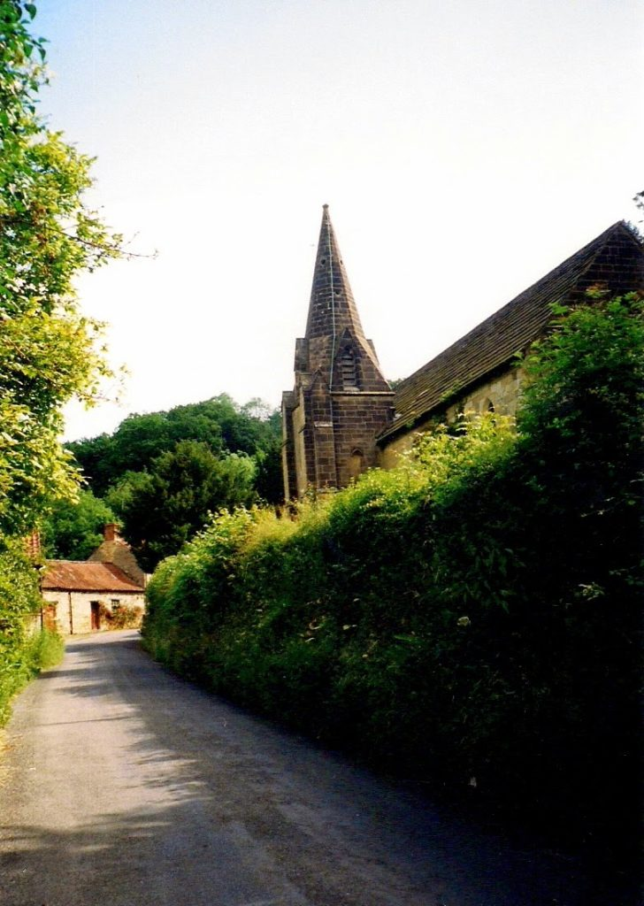 road and small stone chapel