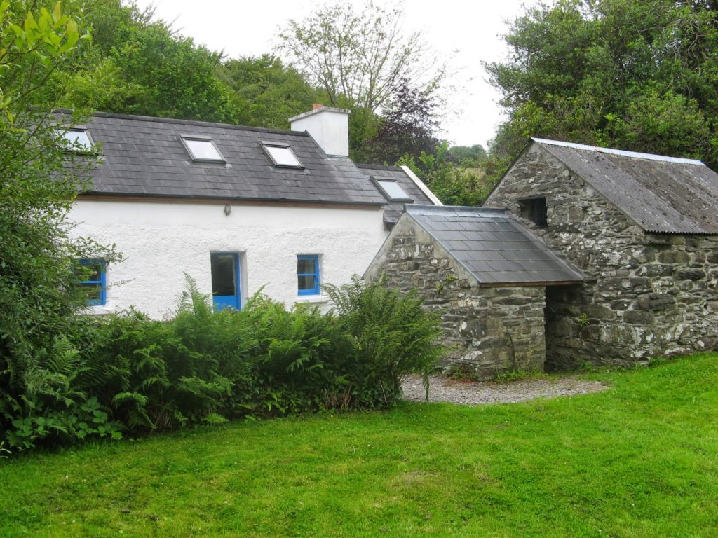 whitewashed stone cottage