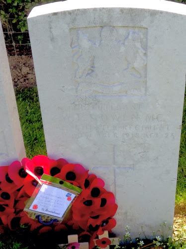 grave of Wilfred Owen in Ors Communal Cemetary, France