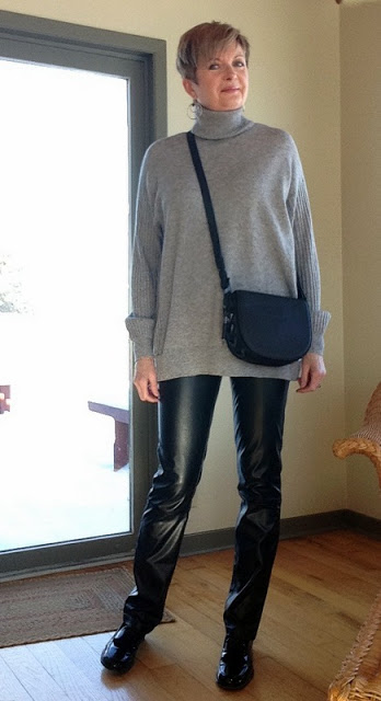Mackage bag with leather pants and a t-neck