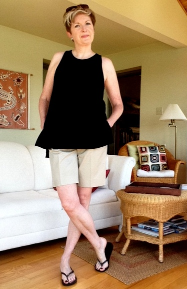Black tank from Aritzia and Brooks Brothers walking shorts