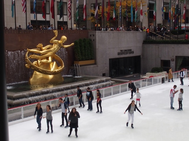 Shot of Prometheus and ice skaters at Rockefeller Center