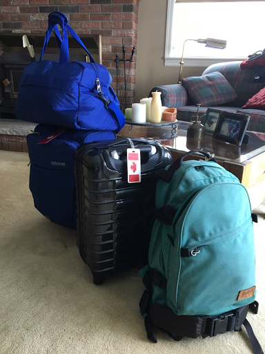 two small 4-wheeler bags and two packs.