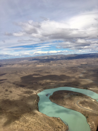 arid plains and green river from the air