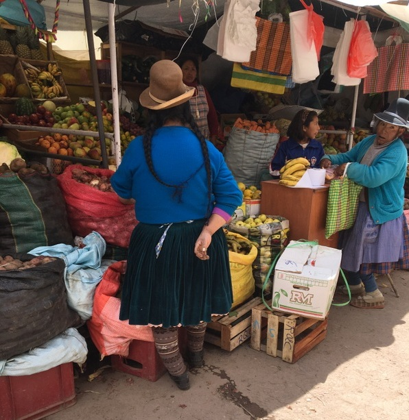Women in traditional hats at the market in Chivay, Peru