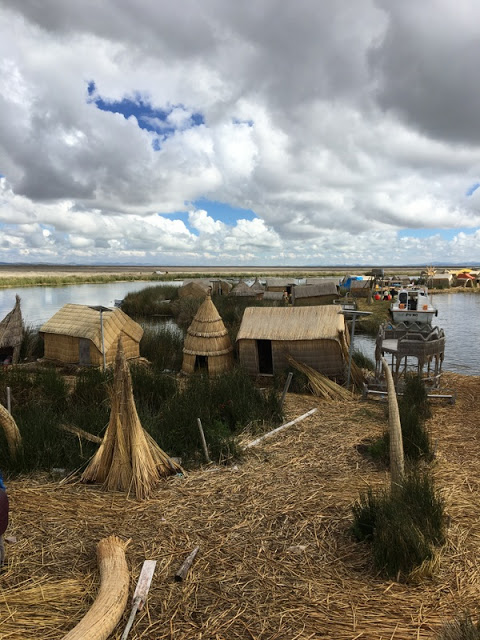 reed buildings on Uros Islands, Lake Titicaca, Puno, Peru