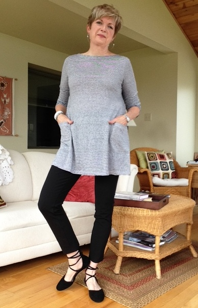black cropped pants, black laced flats, grey and white striped tunic