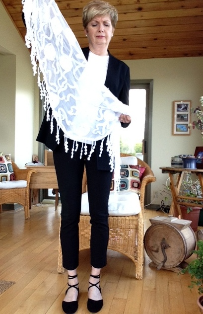 black pants and jacket, black lace-up flats, white tee and white scarf