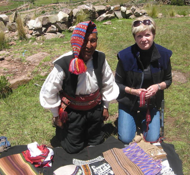 me and the man who made this beautiful belt on Taquile Island, Peru