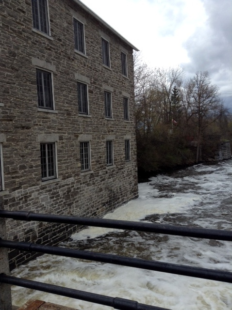 view from the dam of stone grist mill