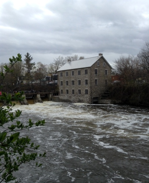 stone grist mill and rushing river