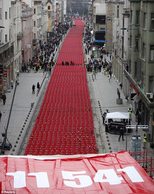 11,541 red chairs, one for each victim of the Siege of Sarajevo