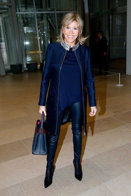 woman in jacket and leather leggings