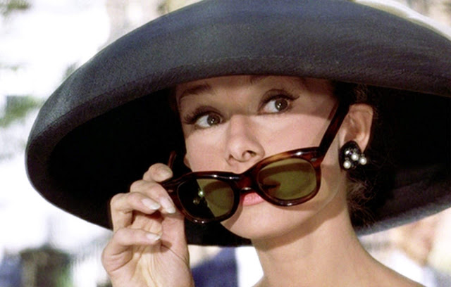 Audrey Hepburn in a hat and sunglasses
