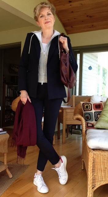 woman in navy suit with burgundy scarf and bag