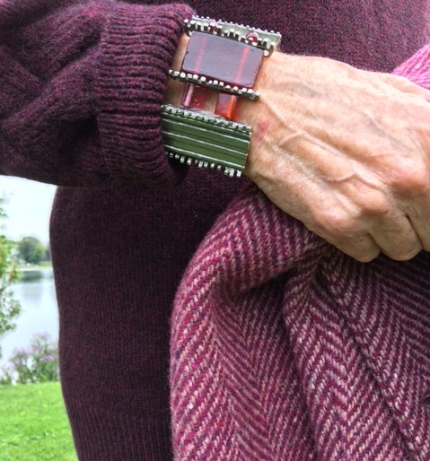 burgundy sweater, bracelet and tweed coat, close-up