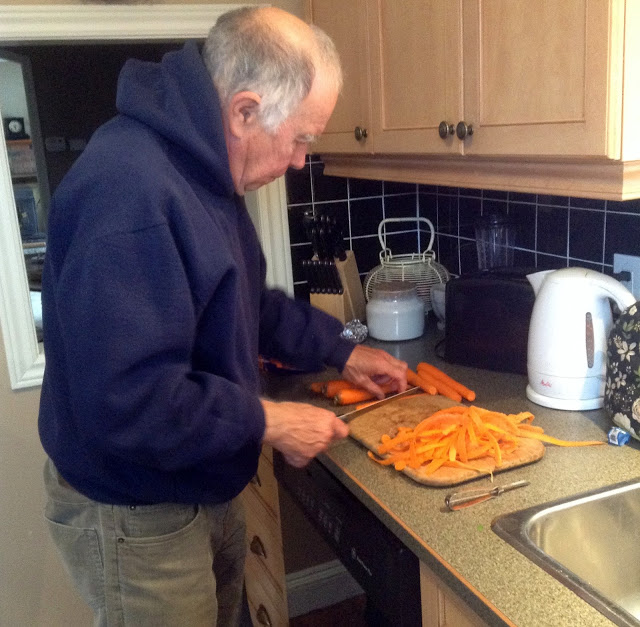 man chopping carrots