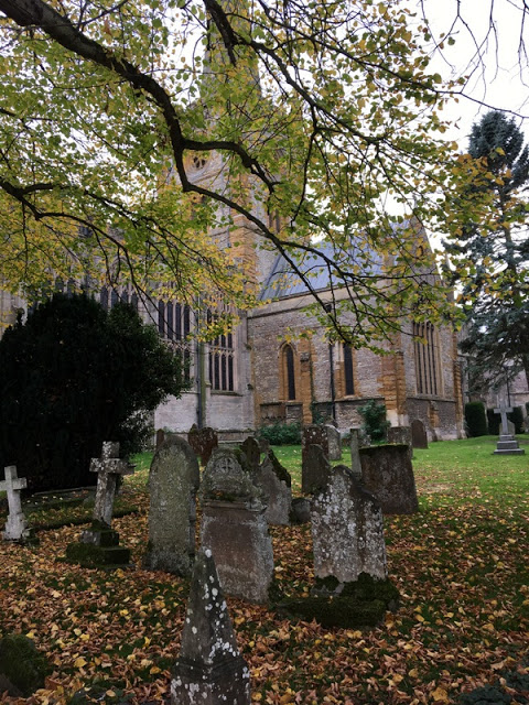 stone church and old graves, fallen leaves