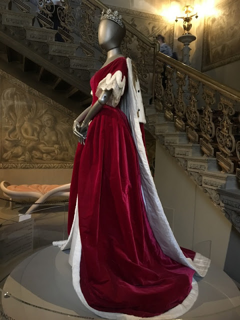 mannequin in a red velvet dress with white fur trimmed train