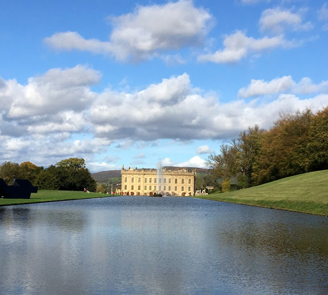 a lake and a stately home on the other side