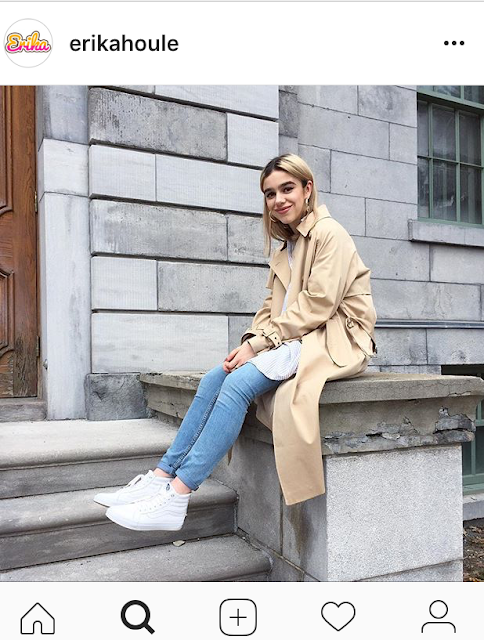 girl in beige trench coat, jeans, and white sneakers