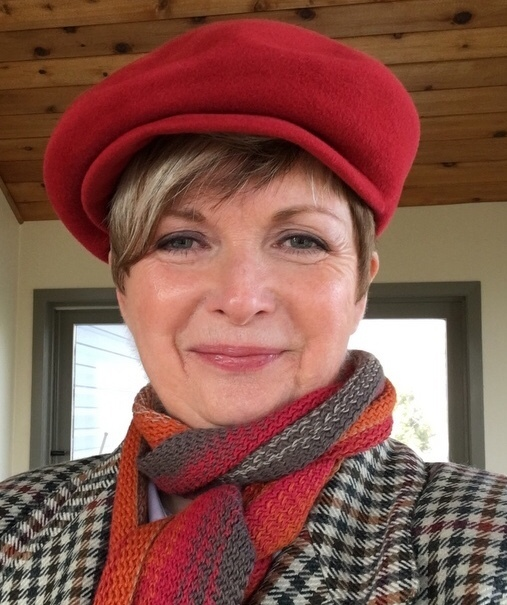 woman in an orange newsboy hat and scarf