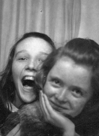 two girls laughing in photo booth, seventies vintage photo