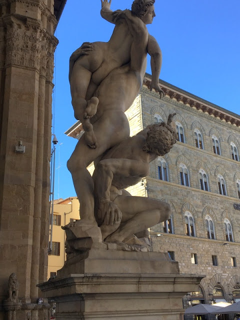 "statue ""The Rape of a Sabine Woman"" by Giambologna in the Loggia dei Lanzi in Florence"