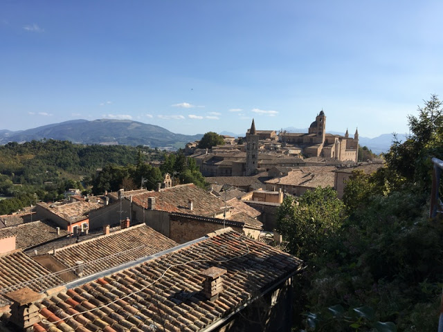 View of Urbino spires and rooftops from the top of the old stone steps in the town.