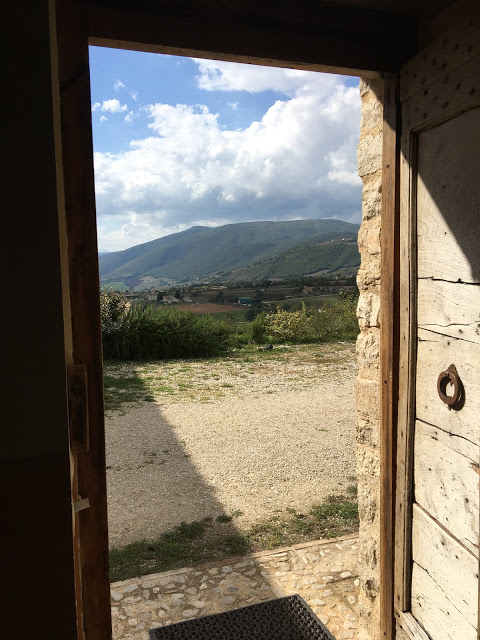 The view across the hills from the doorway of a room at Agriturismo Il Casale Degli Amici