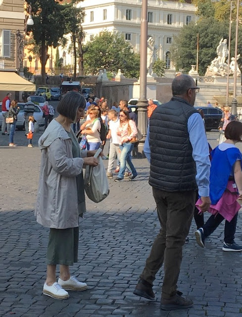woman and man on the street in Rome
