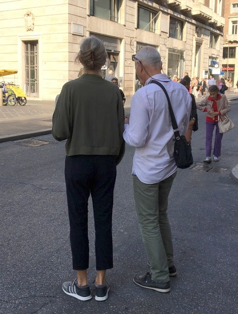 couple standing in a street in Rome