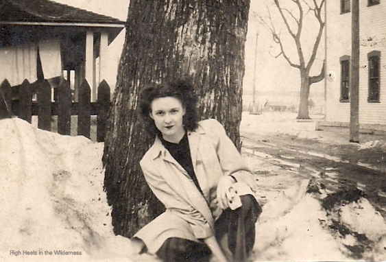 woman in white coat and striped trousers in 1944