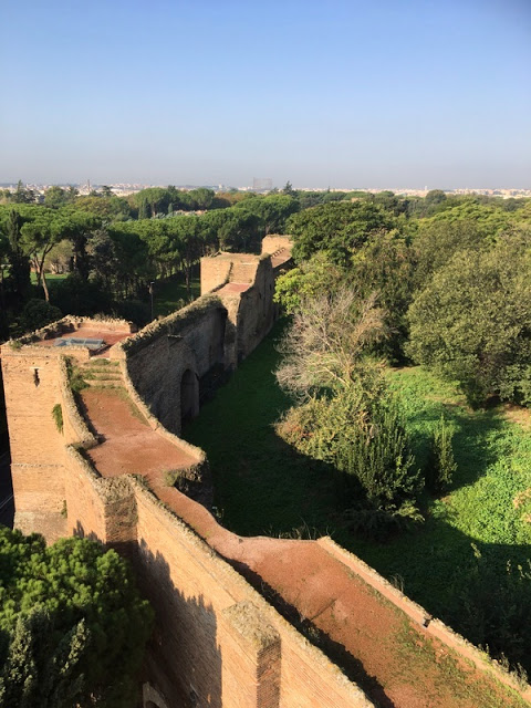 ancient wall of the old city of Rome and a park beyond
