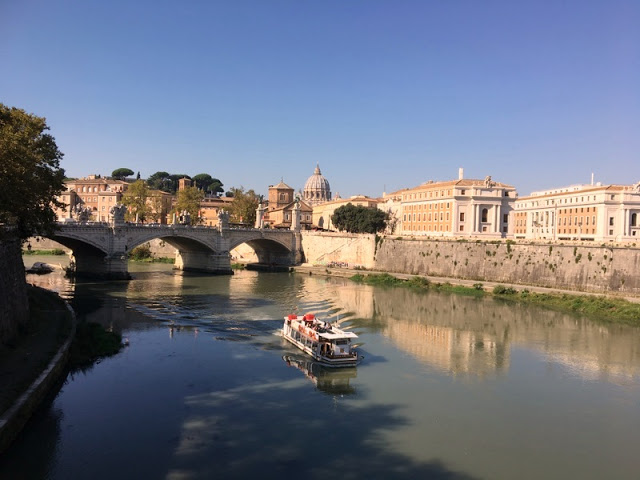 a tour boat sails the placid waters of the Tiger River in Rome, Italy
