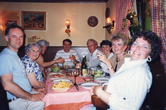 table of friends at dinner in France