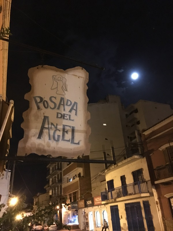 The sign for our hotel, Posada del Angel, in Salta, Argentina by the light of a full moon.