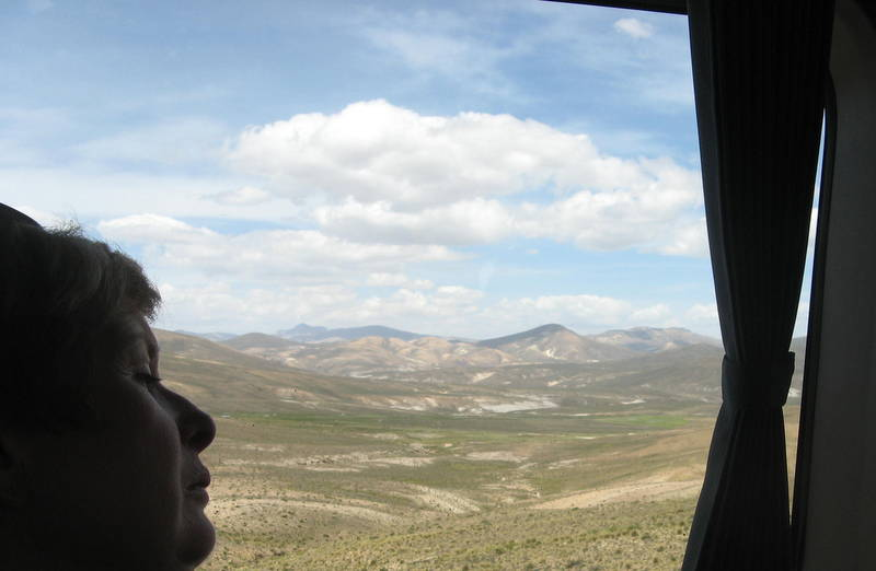 Asleep on a bus from Puno to Cusco, Peru. Beautiful landscape and blue sky out the window.